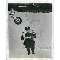 1955 Press Photo Royal Navy Officer in Bosun's Chair Under Helicopter