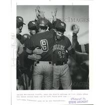 1989 Press Photo Daniel Bruffy gets hero's welcome at home plate after home run.
