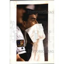1994 Press Photo Brewers baseball's Teddy Higuera seeks refuge in the dugout