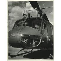 1977 Press Photo Bob Nevins, in cockpit of helicopter - tua13359