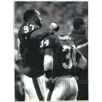 1994 Press Photo Thurman Thomas consoled after fumbling the ball twice.