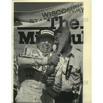 1984 Press Photo Tom Sneva celebrates winning the Dana-Rex Mays 200 - mjx57087