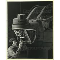 1985 Press Photo Technician works on helicopter parts in Anaheim, California