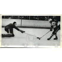 1973 Press Photo Admirals Hockey Player Sandy McAndrew, Minnesota's Greg Page