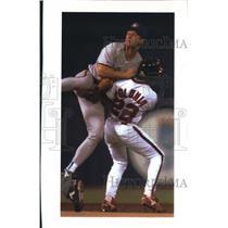 1992 Press Photo Luis Polonia collides with Milwaukee Brewers' Scott Fletcher