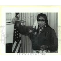 """1995 Press Photo Bert Langley holding an """"Indian Flute"""" at the Chalmette Library"""