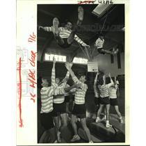 "1987 Press Photo Holy Cross cheer leading squad demonstrates ""Basket"" maneuver"