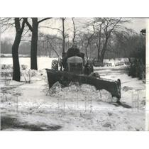1959 Press Photo Maintenance man clears snow with plow.
