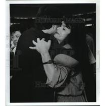 1989 Press Photo Woman from Honduras hugs relatives at Houston airport