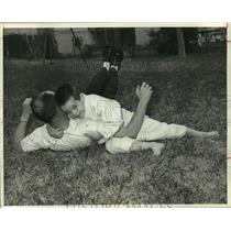 1962 Press Photo Man and boy perform judo in yard - hca36095