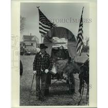 1976 Press Photo Two generations of cowboys teamed up in a donkey pulled wagon.