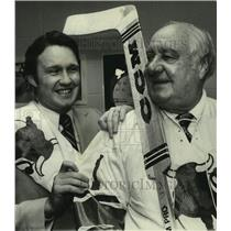 1977 Press Photo Birmingham AL businessman Tom Bradford & man, with hockey stick