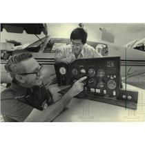 1983 Press Photo Tom Zompolas & son display Pamco system controls at airshow, WI