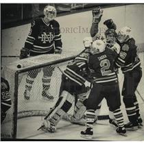 1989 Press Photo Surrounded by the Irish, Tray Tombie celebrates hockey goal