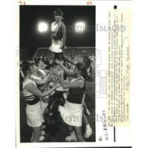 1989 Press Photo Higgins High School Cheerleaders Form Human Springboard