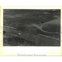 1990 Press Photo Boat Travels the C-38 Channel Near the Kissimmee River, Florida