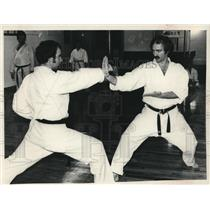 "1982 Press Photo Michael ""Mickey"" Mitchell (l) and Doug Loft during karate match"