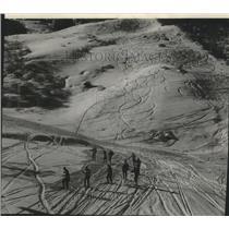 1960 Press Photo Ski patrol works over ski trails in Aspen. Colorado.