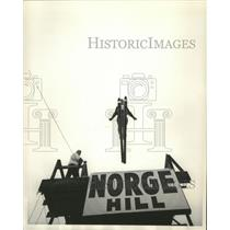1962 Press Photo Skier Jumps Off Norge Hill Toward Landing on the Slope