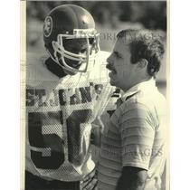 1983 Press Photo St. John's football coach Mike Taake talks to Bill Murrell