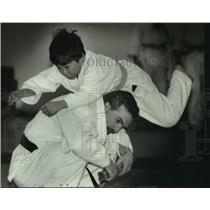 1994 Press Photo Ben Perthel leaps over judo instructor Dan Watts, Germantown