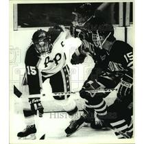 Press Photo RPI's #15 Denis Poissant draws a crowd of defenders in hockey game
