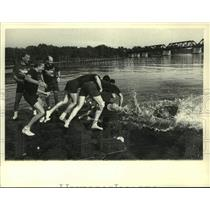 Press Photo Rowing team jumps into Hudson River after win in Albany, NY regatta