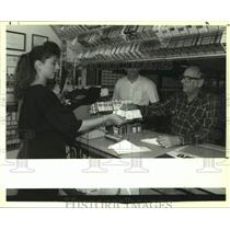 1992 Press Photo Carl Gustafson Buys $42 Worth Of Lotto Tickets From Store Owner
