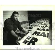 1993 Press Photo Terry Marks of GM Sign Company, rolls signs for shipment
