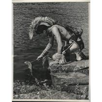 1951 Press Photo Winnebago Native American, Phil, catches a fish for his lunch