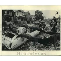 1954 Press Photo Strong storm laid this tree onto car in Milwaukee, Wisconsin