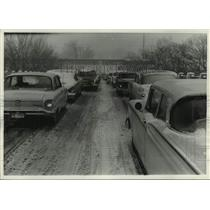 1960 Press Photo Cars travel snow packed Watertown Plank Road in Milwaukee, Wis