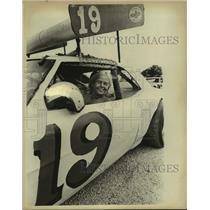 Press Photo Woman in #19 Race Car - sas19701
