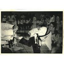 1992 Press Photo Jeff Koenig Jr. shows board breaking skill in Tae Kwon Do.
