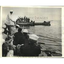 1942 Press Photo Coastguards rescue survivors of torpedoed ship, Atlantic Coast
