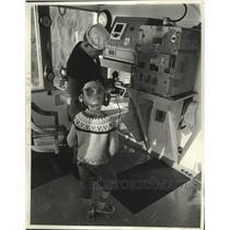 1965 Press Photo U.S Coast Guard shows a boy equipment in the radio shack, WI