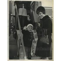 1968 Press Photo Irmgard Shepard & son boarding an airplane in New York