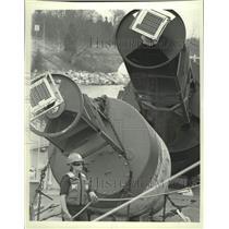 1993 Press Photo Navigational buoys dwarf Coast Guard member Tiffany Solberg