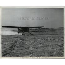 1950 Press Photo The Huskies jet lands on snow covered Battle Harbor, Labrador