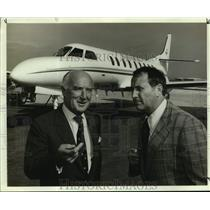 Press Photo R. Bruce Chuber and Peter Cadbury, Aviation Directors near plane