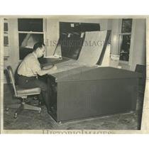1952 Press Photo Lynn L. Means, A Forecaster, Sitting