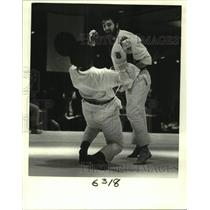 1985 Press Photo Karate players during the match - nob80975