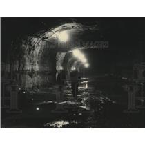 1976 Press Photo Three miners walk through shaft in Occidental mine, Colorado