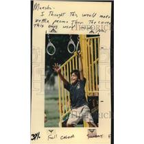 1993 Press Photo Youngster swinging from rings on jungle gym, Texas - saa19078