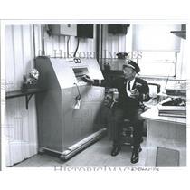 1961 Press Photo Rouge Andrew Sassack alarm center