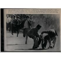 1975 Press Photo Demonstrators Lisborn Tear Gas - RRX54885