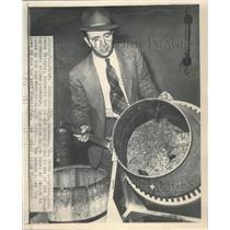 1949 Press Photo Lt. David Laughlin Inspects Mixer - RRW44635