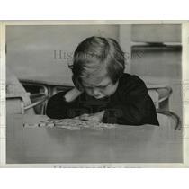 1938 Press Photo worried school girl in France, WWII - RRX76685