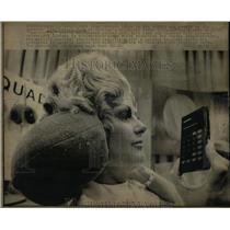 1974 Press Photo Electronics Show Simmons Hear Muffs - RRW90437