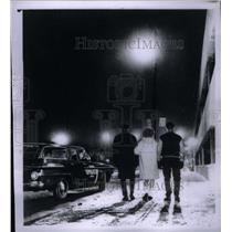 1963 Press Photo teenagers walk down snowy street - RRX48717